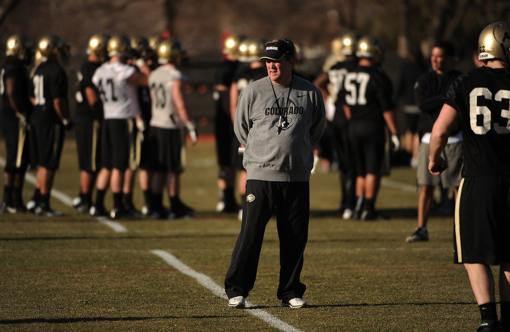 . BOULDER, CO- MARCH 7 :  Head coach Mike MacIntyre watches players during practice. The Colorado Buffaloes football team hit the practice field for the first time this season with new head coach Mike MacIntyre in Boulder, CO on March 7, 2013. (Photo By Helen H. Richardson/ The Denver Post)