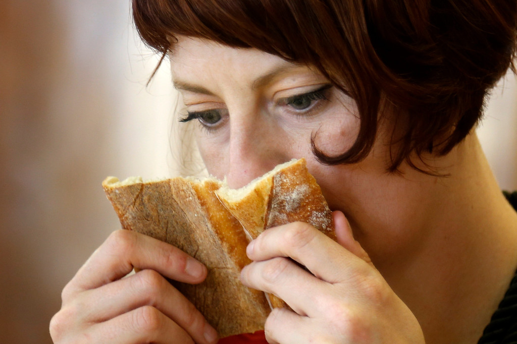 . Meg Zimbeck, U.S. Cooking journalist, sniffs a baguette, French bread, in competition for the \'Grand Prix de la Baguette de la Ville de Paris\' (Best Baguette of Paris 2013) annual prize at the Chambre Professionnelle des Artisans Boulangers Patissiers in Paris April 25, 2013. The baguette is a French cultural symbol par excellence and the competition saw 203 Parisian bakers who compete for recognition as finest purveyor of one of France\'s most iconic staples. The baguettes are registered, given anonymous white wrappings and an identification number. They are then carefully weighed and measured to ensure they do not violate the contest\'s strict rules. 52 entries were withdrawn for failing to measure between 55-70cm long or not matching the acceptable weight of between 250-300g. Every year, the winner earns the privilege of baking bread for the French President.   REUTERS/Charles Platiau