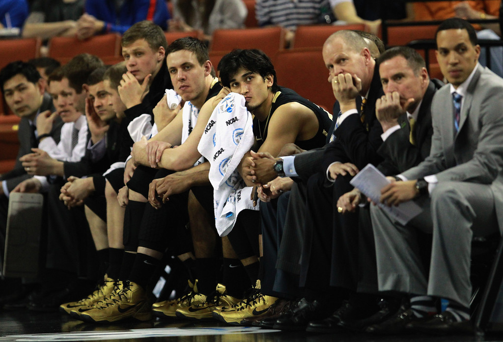 . AUSTIN, TX - MARCH 22:  Head coach Tad Boyle and Sabatino Chen #23 of the Colorado Buffaloes sit on the bench in the final minutes of the game against the Illinois Fighting Illini during the second round of the 2013 NCAA Men\'s Basketball Tournament at The Frank Erwin Center on March 22, 2013 in Austin, Texas.  Illinois defeated Colorado 57-49. (Photo by Ronald Martinez/Getty Images)