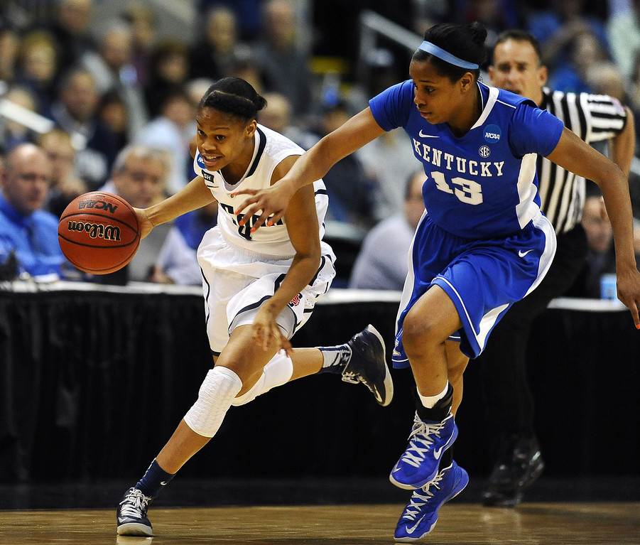 . Connecticut guard Moriah Jefferson, left, sprints down court against Kentucky guard Bria Goss (13) in the first half of a women\'s NCAA regional final basketball game in Bridgeport, Conn., Monday, April 1, 2013. (AP Photo/Jessica Hill)
