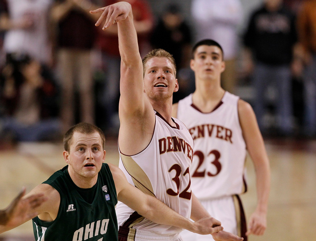 . Denver guard Chse Hallam, center, reacts after hitting a free throw with seconds remaining in the second half as Ohio guard Travis Wilkinsm, front, and Denver guard Brett Olson look on in Denver\'s 61-57 victory in a first-round NIT college basketball game in Denver on Tuesday, March 19, 2013. (AP Photo/David Zalubowski)