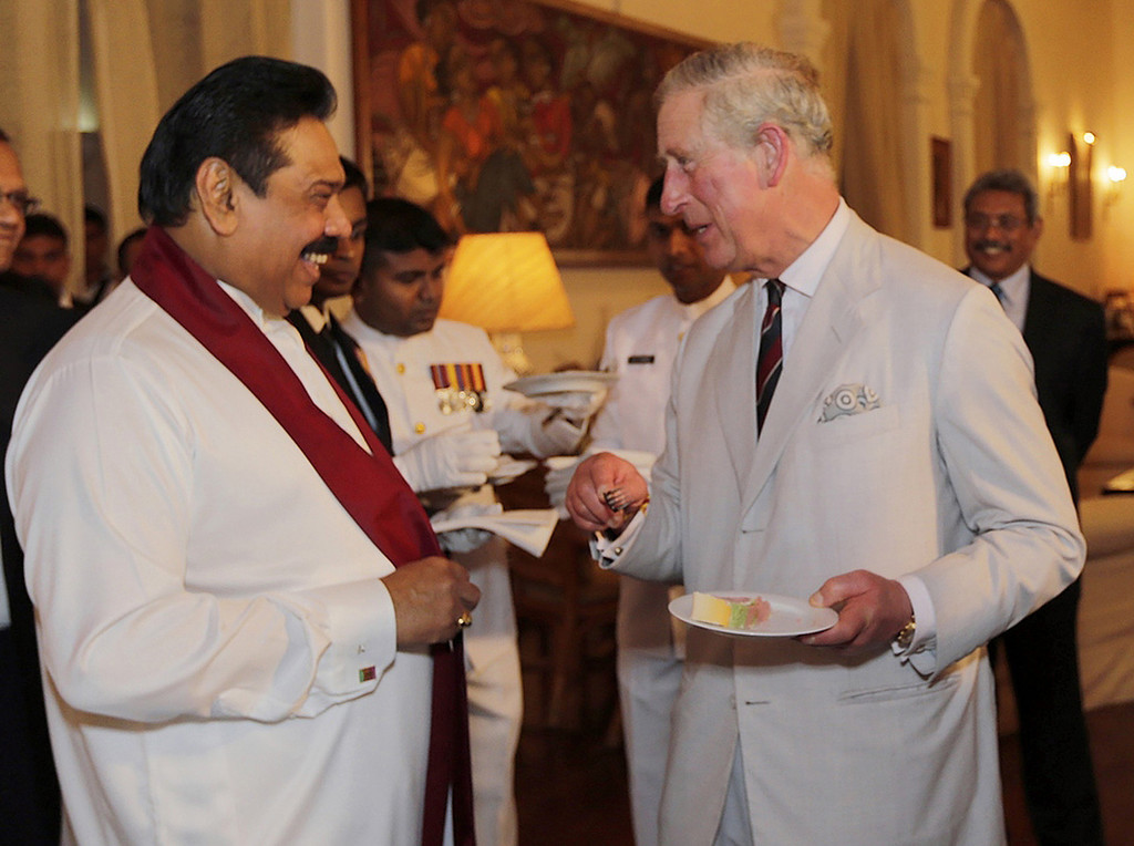 . In this handout photograph received from the President\'s Office on November 14, 2013 Britain\'s Prince Charles (R) shares a light moment with Sri Lankan President Mahinda Rajapaksa during a reception at the President\'s residence in Colombo on November 14, 2013.  AFP PHOTO / PRESIDENT\'S OFFICE-HO/AFP/Getty Images