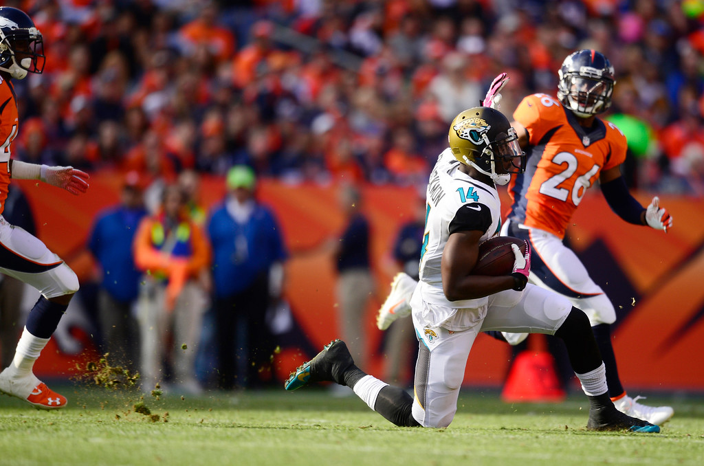 . Jacksonville Jaguars wide receiver Justin Blackmon (14) trips up after gaining 20 yards in the third quarter. The Denver Broncos take on the Jacksonville Jaguars at Sports Authority Field at Mile High in Denver on October 13, 2013. (Photo by AAron Ontiveroz/The Denver Post)