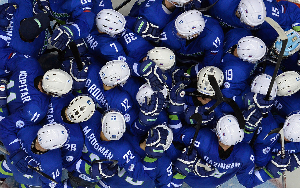 . Slovenia\'s players celebrate at the end of the Men\'s Ice Hockey Group A match Slovakia vs Slovenia at the Bolshoy Ice Dome during the Sochi Winter Olympics on February 15, 2014. Slovenia won 1-3. ALEXANDER NEMENOV/AFP/Getty Images