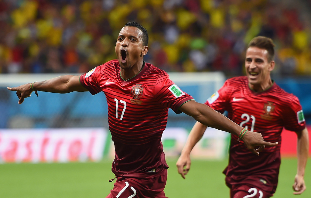 . Nani of Portugal (L) celebrates scoring his team\'s first goal during the 2014 FIFA World Cup Brazil Group G match between the United States and Portugal at Arena Amazonia on June 22, 2014 in Manaus, Brazil.  (Photo by Christopher Lee/Getty Images)