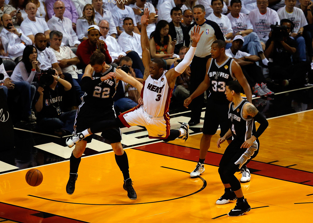 . MIAMI, FL - JUNE 10: Dwyane Wade #3 of the Miami Heat loses the ball as Tiago Splitter #22 of the San Antonio Spurs defends during Game Three of the 2014 NBA Finals at American Airlines Arena on June 10, 2014 in Miami, Florida.  (Photo by Chris Trotman/Getty Images)