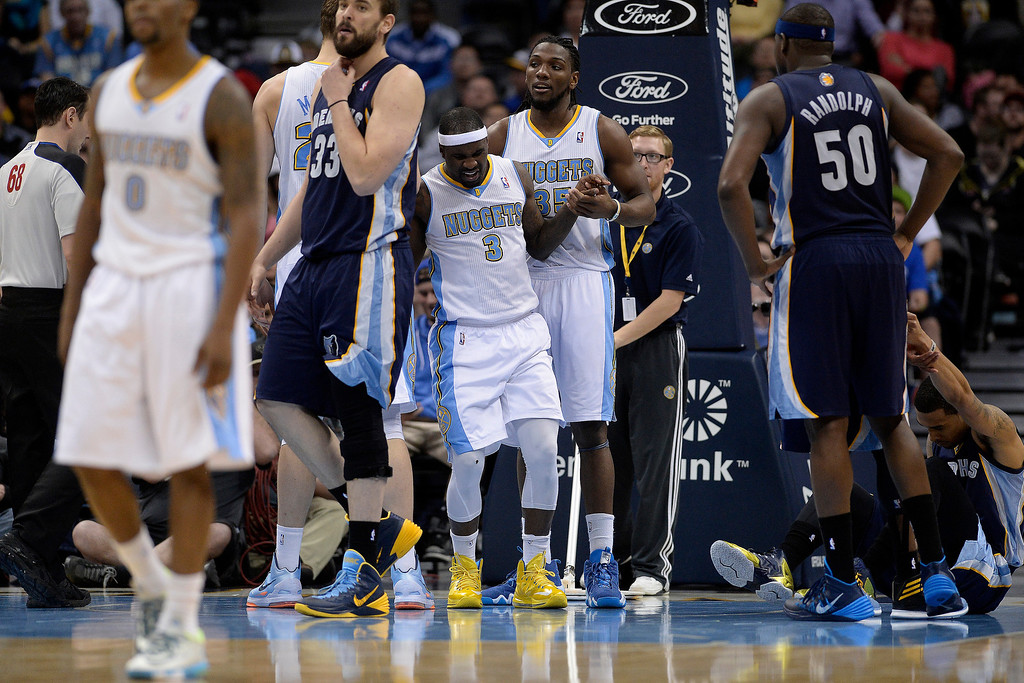 . Denver Nuggets guard Ty Lawson (3) gets helped up by forward Kenneth Faried (35) after taking a hard foul from Memphis Grizzlies guard Courtney Lee (5) during the fourth quarter of the Grizzlies\' 94-92 win. (Photo by AAron Ontiveroz/The Denver Post)