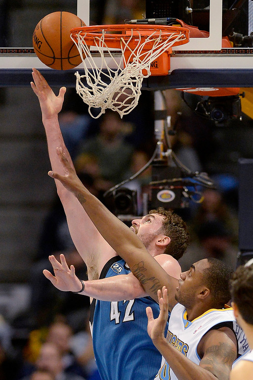 . Kevin Love (42) of the Minnesota Timberwolves takes it up against Darrell Arthur (00) of the Denver Nuggets during the first quarter at the Pepsi Center.   (Photo By AAron Ontiveroz/The Denver Post)