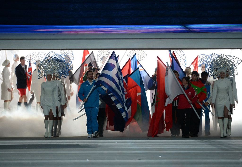 . Flag bearers parade ahead of athletes during the Closing Ceremony of the Sochi Winter Olympics at the Fisht Olympic Stadium on February 23, 2014.  PETER PARKS/AFP/Getty Images