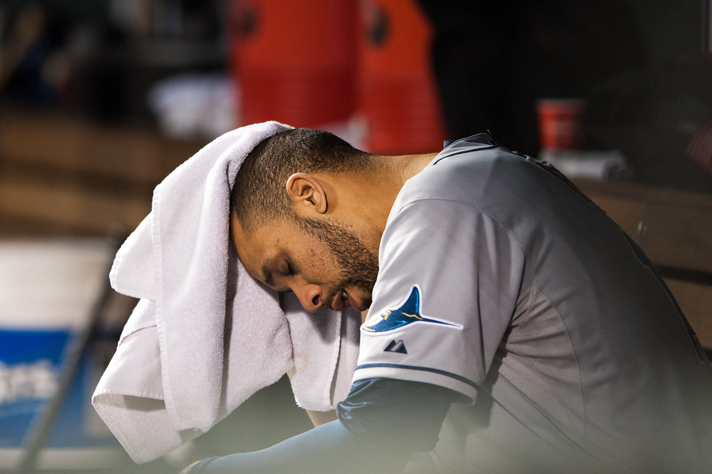 . DENVER, CO - MAY 4:  David Price #14 of the Tampa Bay Rays shows his disappointment as he wipes away his sweat in the dugout after being relieved in the seventh inning of a game against the Colorado Rockies at Coors Field on May 4, 2013 in Denver, Colorado.  (Photo by Dustin Bradford/Getty Images)