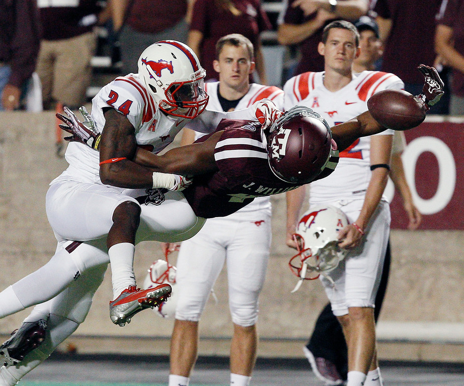 . SMU defensive back JR Richardson (24) breaks up the pass intended for Texas A&M\'s Ja\'Quay Williams (4) in the fourth quarter during an NCAA college football game Saturday, Sept. 21, 2013, in College Station, Texas. Texas A&M won 42-13. (AP Photo/Bob Levey)