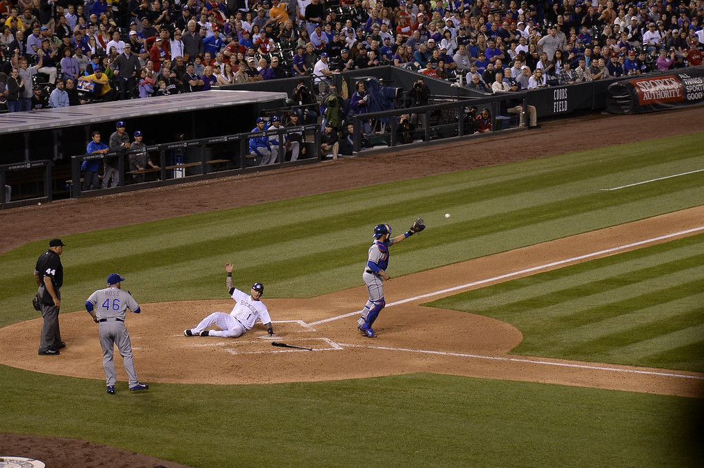 . DENVER, CO - MAY 06: Colorado Rockies right fielder Brandon Barnes (1) slides home for a score the sixth inning as Texas Rangers catcher J.P. Arencibia (7) gets the throw late May 6, 2014 at Coors Field. (Photo by John Leyba/The Denver Post)