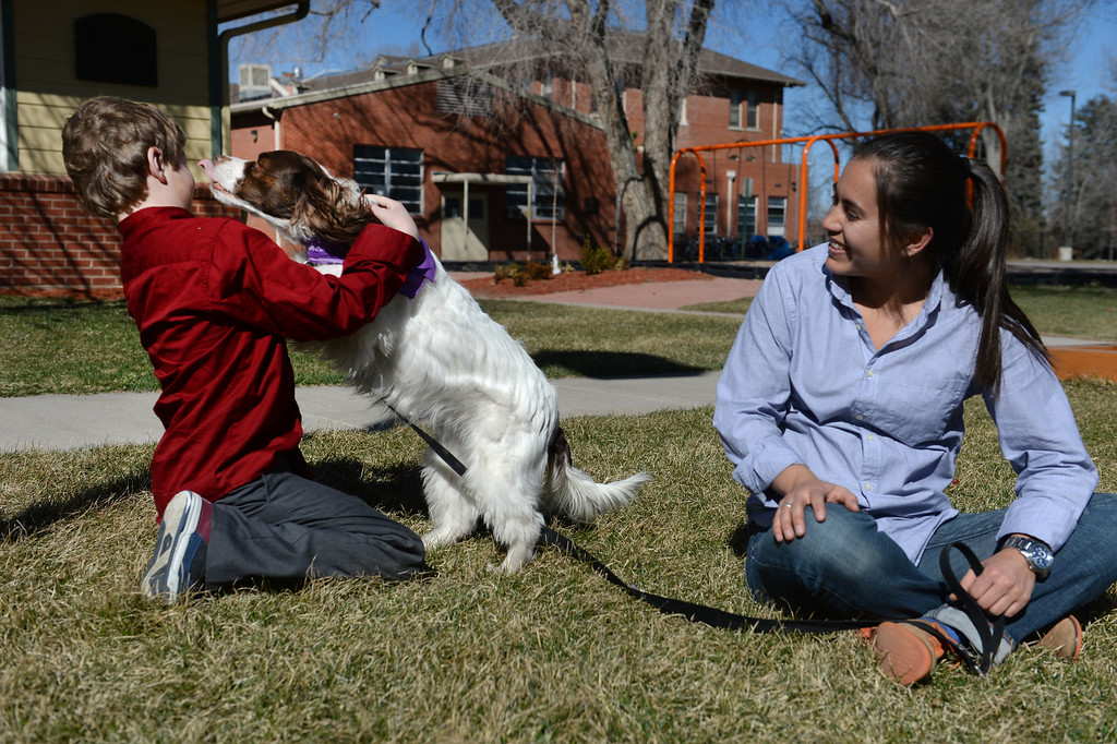 . After school children have time to play outside or play with animal assisted therapy dog Charlie, 2 and her owner Jessica Pfeiffer, right, an animal assisted therapist at  Mount Saint Vincent Home in in Denver,  Co on March 19, 2014. (Photo By Helen H. Richardson/ The Denver Post)