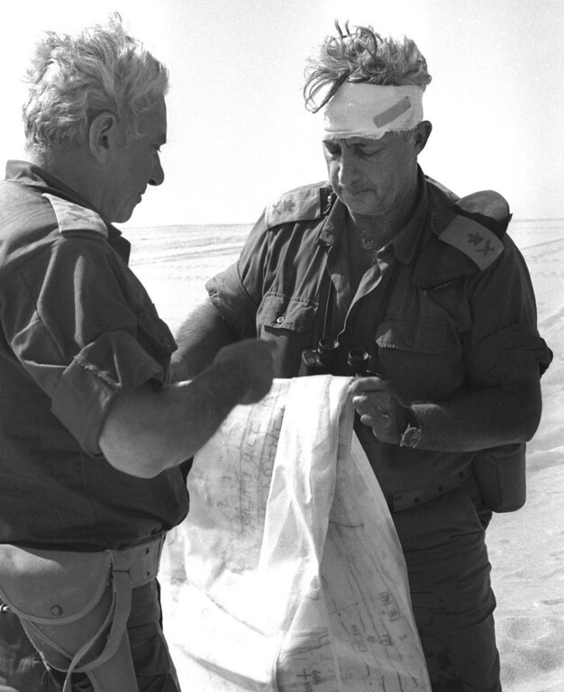 . In this Oct. 10, 1973 file photo, Maj. Gen. Ariel Sharon, right, views a map together with Maj. Gen. Haim Bar-Lev in the Sinai desert, during the 1973 Middle East War. Sharon, the hard-charging Israeli general and prime minister who was admired and hated for his battlefield exploits and ambitions to reshape the Middle East, died Saturday, Jan. 11, 2014.  (AP Photo/Israel Government Press Office, File)