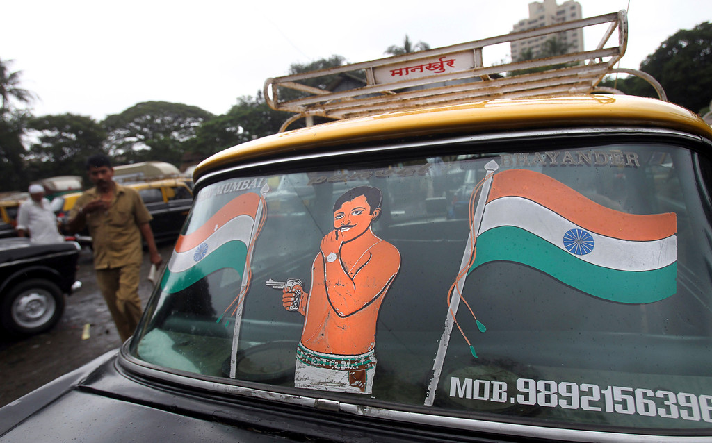 . In this Tuesday, July 30, 2013, Indian flag is painted on the back windshield of a Mumbai Premier Padmini taxi, in Mumbai, India. More than 4500 Premier Padmini taxis are expected to be banned from the roads in Mumbai this year, starting in August,  in line with a government order that bans cabs that are more than 20 years old. (AP Photo/Rafiq Maqbool)
