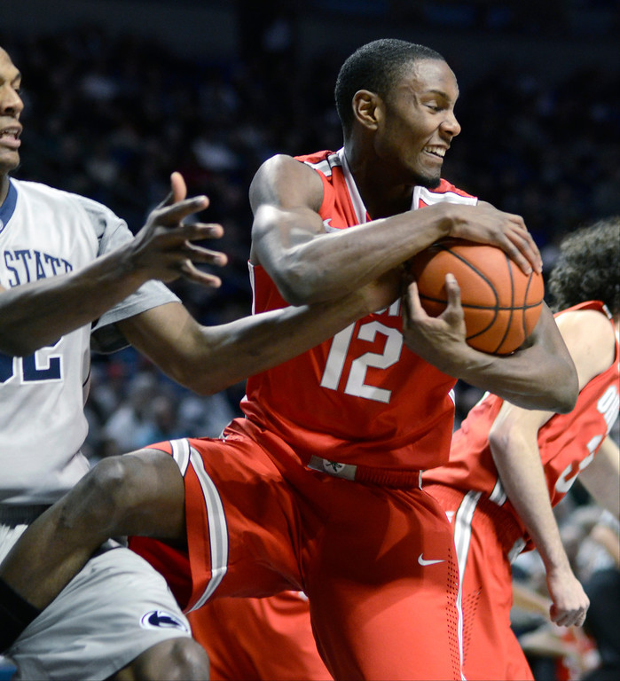 . Ohio State\'s Sam Thompson takes possession of a rebound during the first half of an NCAA college basketball game against Penn State, Thursday, Feb. 27, 2014, in State College, Pa. (AP Photo/Ralph Wilson)