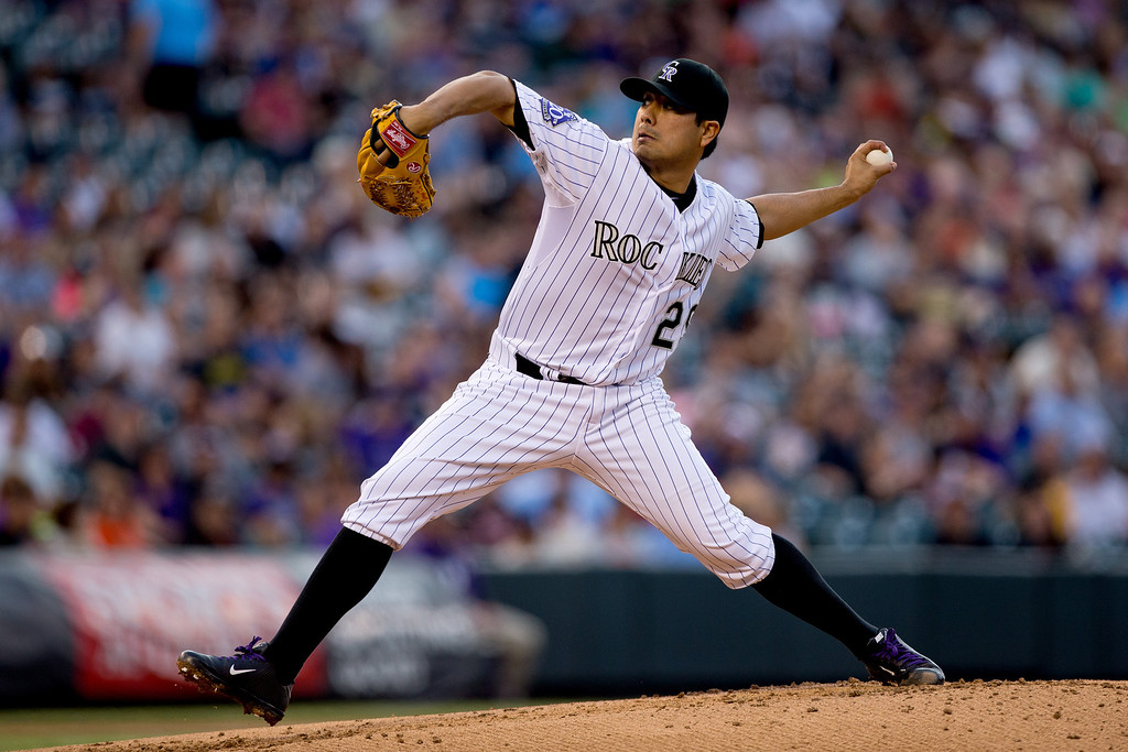 . DENVER, CO - MAY 17:  Starting pitcher Jorge de la Rosa #29 of the Colorado Rockies delivers to home plate during the second inning against the San Francisco Giants at Coors Field on May 17, 2013 in Denver, Colorado.  (Photo by Justin Edmonds/Getty Images)