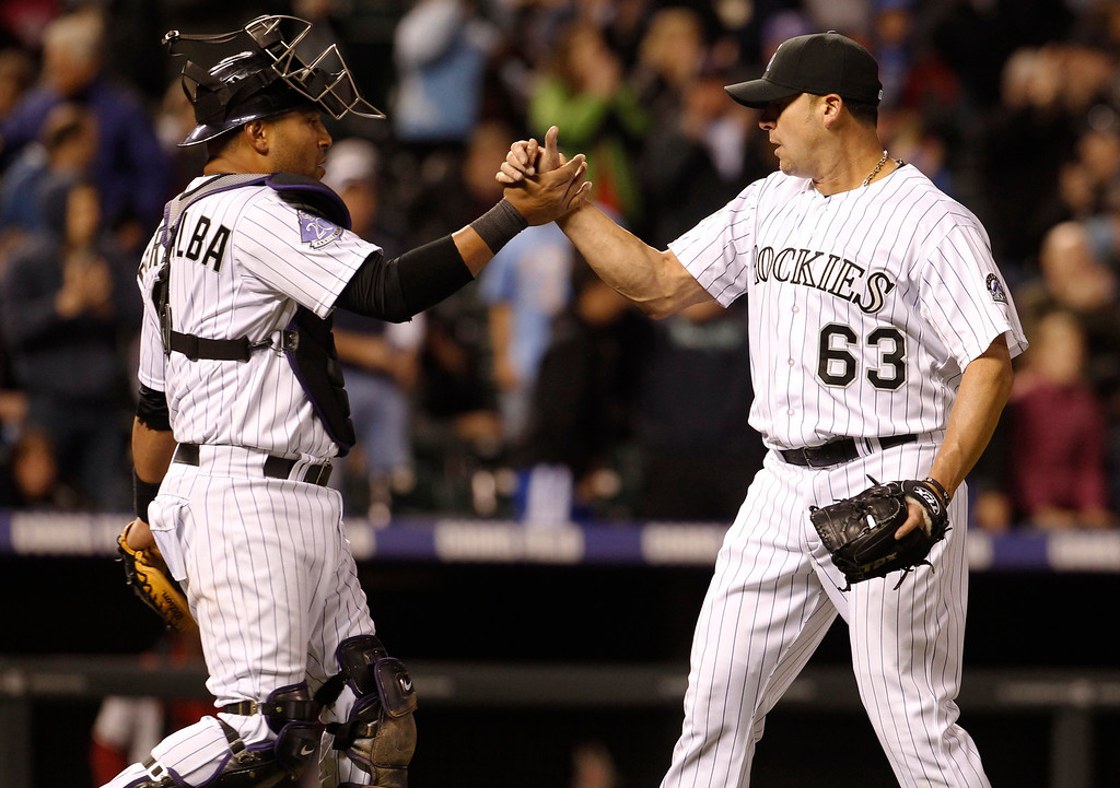 . Colorado Rockies catcher Yorvit Torrealba, left, congratulates relief pitcher Rafael Betancourt who retired Arizona Diamondbacks\' Wil Nieves for the final out in the ninth inning of the Rockies\' 4-3 victory in a baseball game in Denver, Saturday, April 20, 2013. Betancourt earned his seventh save of the season. (AP Photo/David Zalubowski)