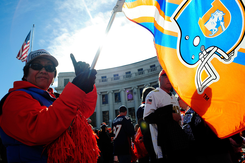 . Bert Norton of Centennial, CO, waves a Broncos flag she has owned since 1978, in front of the City and County Building in Denver, Colorado, Sunday, January 26, 2014. The noon rally brought out scores of supporters and included an appearance by Governor John Hickenlooper and Denver Mayor Michael Hancock.  (Photo By Brenden Neville / Special to The Denver Post)