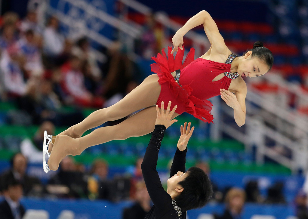 Description of . Narumi Takahashi and Ryuichi Kihara of Japan compete in the pairs short program figure skating competition at the Iceberg Skating Palace during the 2014 Winter Olympics, Tuesday, Feb. 11, 2014, in Sochi, Russia. (AP Photo/Darron Cummings)