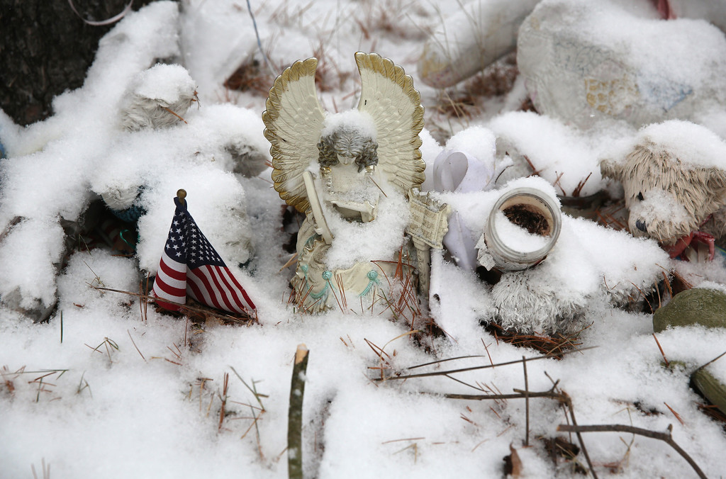. Fresh snow covers a memorial near the former site of Sandy Hook Elementary school on December 14, 2013 in Newtown, Connecticut. One year ago Adam Lanza shot and killed 20 first graders and six adults at the school. Authorities demolished the school in October. Newtown decided not to hold a public memorial on the anniversary out of respect for victims\' survivors, and the town appealed for privacy.  (Photo by John Moore/Getty Images)