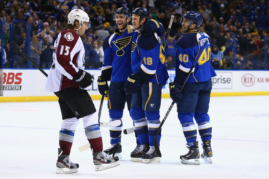 . ST. LOUIS, MO - NOVEMBER 14:  Alex Pietrangelo #27, Jay Bouwmeester #19 and Maxim Lapierre #40 of the St. Louis Blues celebrate Bouwmeester\'s goal as P.A. Parenteau #15 of the Colorado Avalanche returns to the bench at the Scottrade Center on November 14, 2013 in St. Louis, Missouri.  The Blues beat the Avalanche 7-3.  (Photo by Dilip Vishwanat/Getty Images)