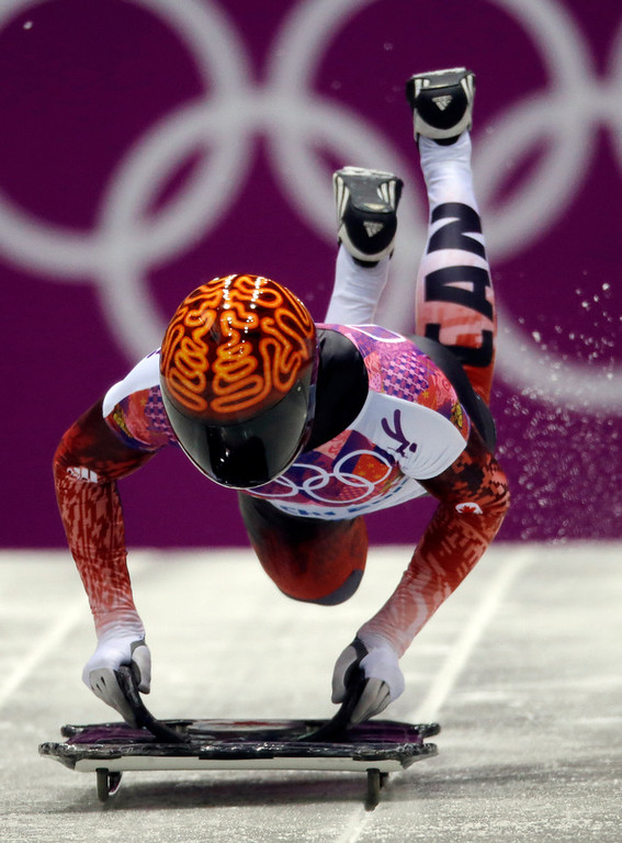 . John Fairbairn of Canada starts his third run during the men\'s skeleton competition at the 2014 Winter Olympics, Saturday, Feb. 15, 2014, in Krasnaya Polyana, Russia. (AP Photo/Dita Alangkara)