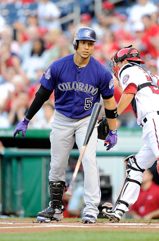 . Carlos Gonzalez #5 of the Colorado Rockies tosses his bat after striking out in the first inning against the Washington Nationals at Nationals Park on June 21, 2013 in Washington, DC.  (Photo by Greg Fiume/Getty Images)