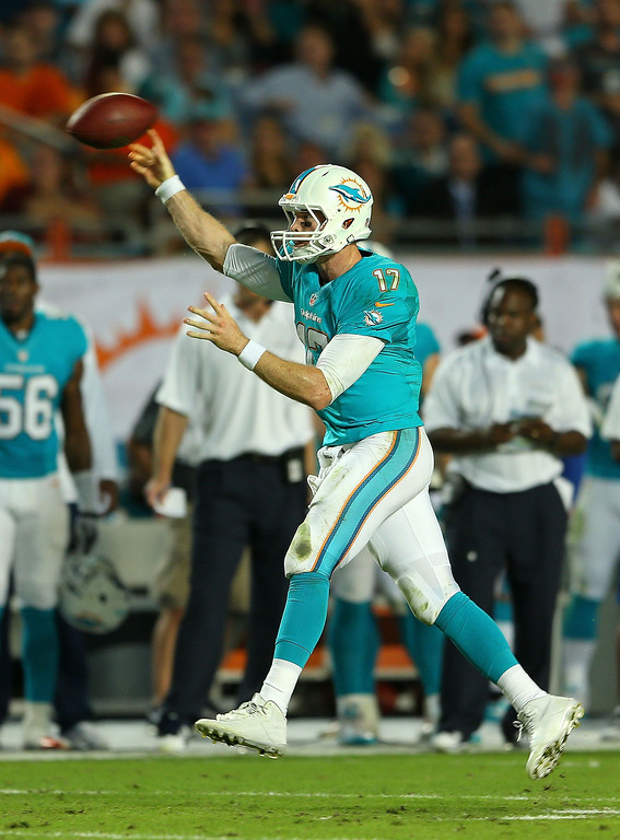 . MIAMI GARDENS, FL - OCTOBER 31:  Ryan Tannehill #17 of the Miami Dolphins passes  during a game against the Cincinnati Bengals at Sun Life Stadium on October 31, 2013 in Miami Gardens, Florida.  (Photo by Mike Ehrmann/Getty Images)