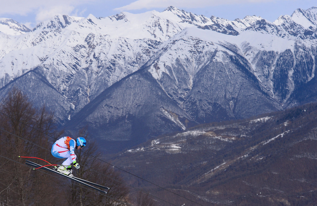 . Austria\'s Matthias Mayer competes during the Men\'s Alpine Skiing Downhill at the Rosa Khutor Alpine Center during the Sochi Winter Olympics on February 9, 2014.   DIMITAR DILKOFF/AFP/Getty Images