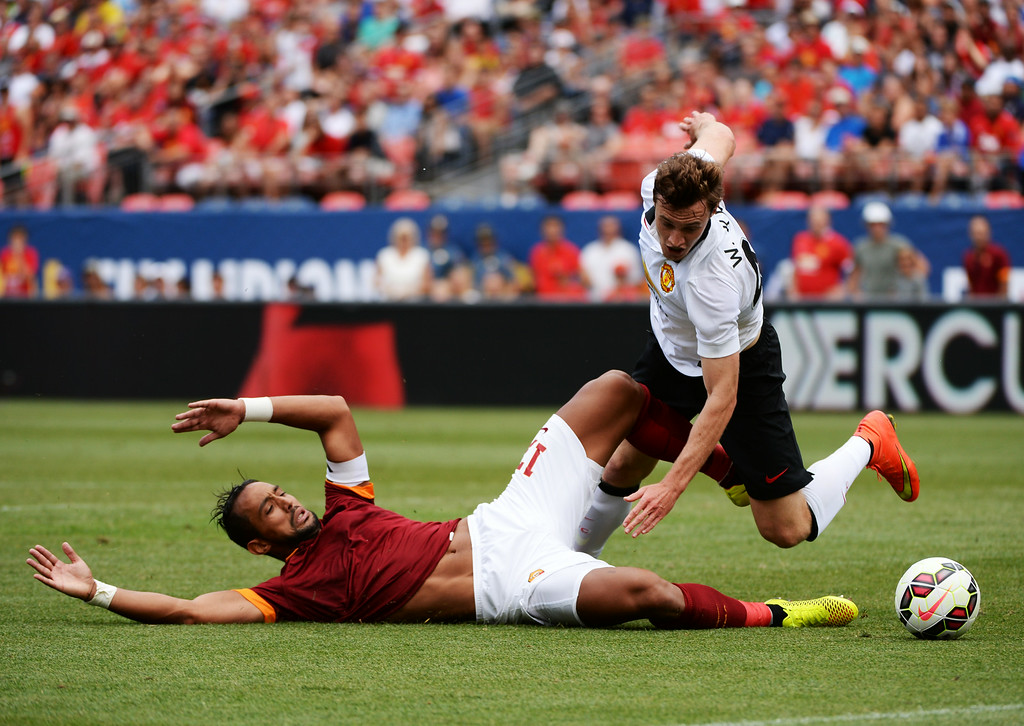 . Will Keane of Manchester United (48), right, and Mehdi Benatia of AS Roma (17) fighting for the control of the ball during Guinness International Champions Cup 2014 at Sports Authority Field at Mile High in Denver, Colorado,  July 26, 2014. (Photo by Hyoung Chang/The Denver Post)