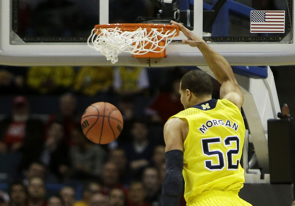 . Jordan Morgan #52 of the Michigan Wolverines dunks against Wofford Terriers in the first half during the second round of the 2014 NCAA Men\'s Basketball Tournament at BMO Harris Bradley Center on March 20, 2014 in Milwaukee, Wisconsin.  (Photo by Mike McGinnis/Getty Images)