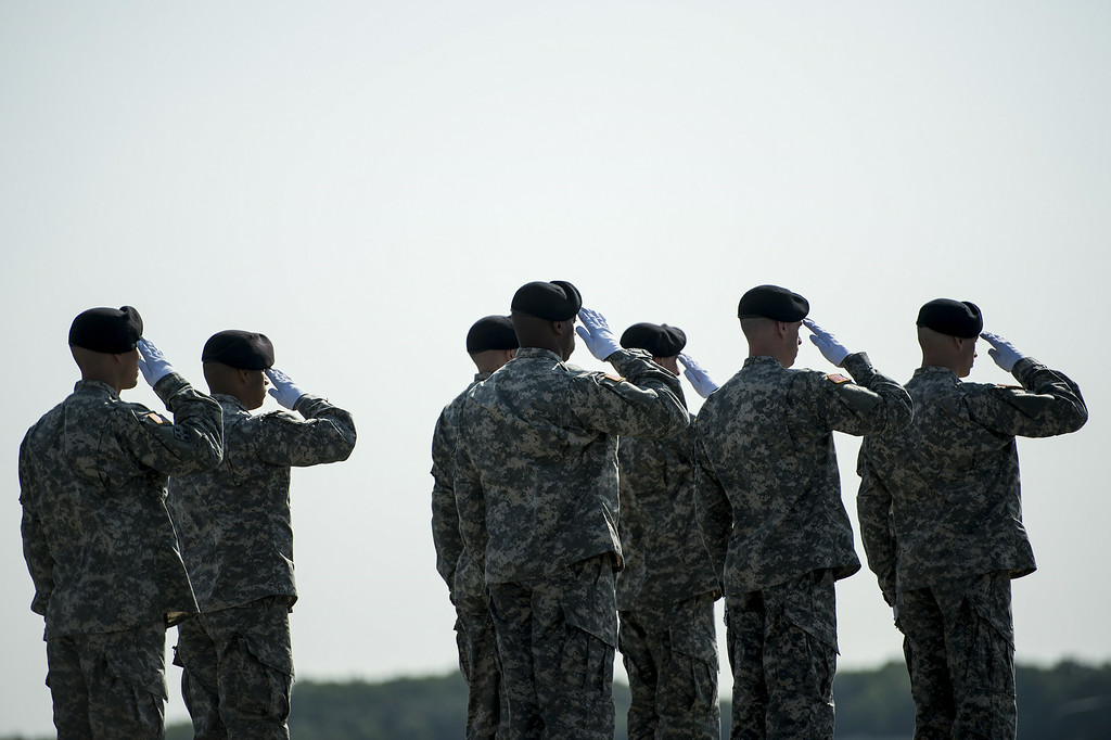 . A US Army carry team salutes as the remains of US Army Maj. Gen. Harold J. Greene are driven away during a dignified transfer at Dover Air Force Base August 7, 2014 in Delaware. AFP PHOTO/Brendan SMIALOWSKI/AFP/Getty Images