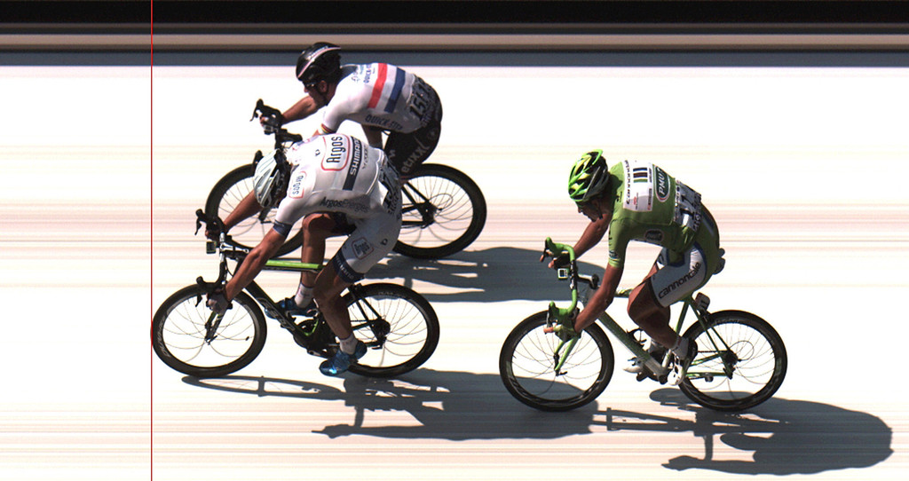 . In this photo finish image provided by ASO, Marcel Kittel of Germany, front, crosses the finish line ahead of second place Mark Cavendish of Britain, rear, and third place Peter Sagan of Slovakia, right, to win the twelfth stage of the Tour de France cycling race over 218 kilometers (136.2 miles) with start in in Fougeres and finish in Tours, western France, Thursday July 11 2013. (AP Photo/ASO, HO)