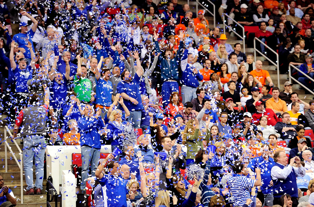 . Memphis Tigers fans throw confetti after the team\'s first basket against the Virginia Cavaliers during the third round of the 2014 NCAA Men\'s Basketball Tournament at PNC Arena on March 23, 2014 in Raleigh, North Carolina.  (Photo by Grant Halverson/Getty Images)