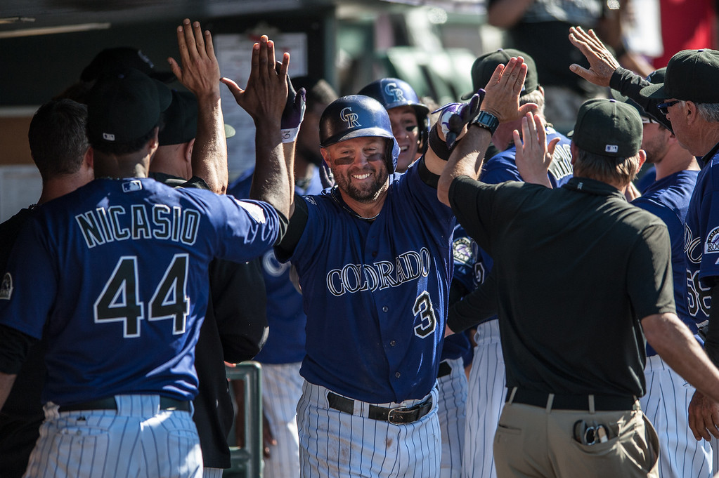 . DENVER, CO - JUNE 1:  Michael Cuddyer #3 of the Colorado Rockies celebrates a game-tying two-run home run in the seventh inning of a game against the Los Angeles Dodgers at Coors Field on June 1, 2013 in Denver, Colorado. The Rockies beat the Dodgers 7-6 in 10 innings. (Photo by Dustin Bradford/Getty Images)
