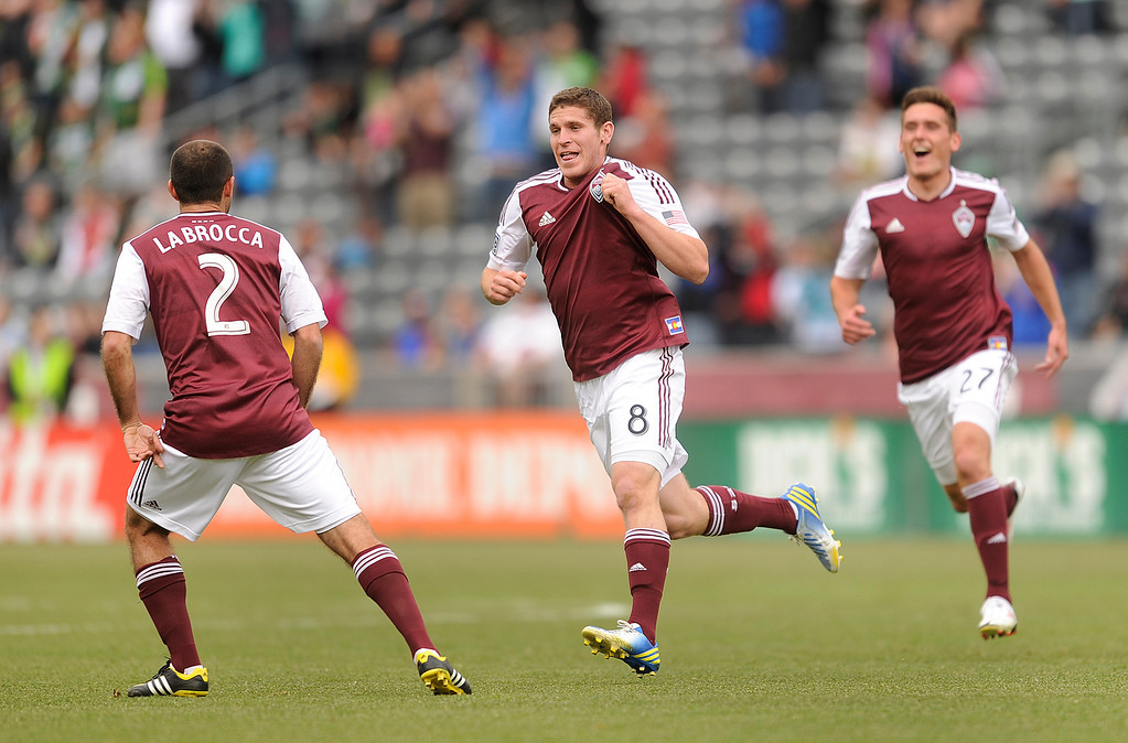 . Dillon Powers (8) of the Colorado Rapids celebrated his first half goal. The Colorado Rapids hosted the Portland Timbers Saturday, March 30, 2013 at Dick\'s Sporting Goods Park in Commerce City.  Photo By Karl Gehring/The Denver Post)