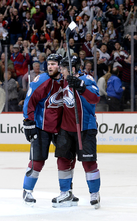. Matt Duchene celebrated with Ryan O\'Reilly after O\'Reilly\'s goal in the third period. The Colorado Avalanche defeated the Chicago Blackhawks 3-2 at the Pepsi Center Wednesday night, March 12, 2014 in Denver, Colorado. (Photo by Karl Gehring/The Denver Post)