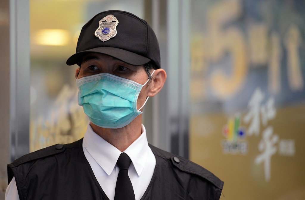 . A masked security guard stand outside Taipei Hoping Hospital on April 6, 2013 where new isolation units have been set up to treat potential new H7N9 avian influenza cases.  Taiwan enhanced its level of alert against bird flu and set up a contingency centre on April 3 after reports in mainland China of new infections from a new strain of avian influenza. The new infections alarmed the authorities in Taiwan, which is separated from the Chinese mainland only by a 180-kilometre (111.6 miles) strait and which has seen a dramatic influx of 2.6 million Chinese visitors last year due to the fast warming ties between Taipei and Beijing.  SAM YEH/AFP/Getty Images