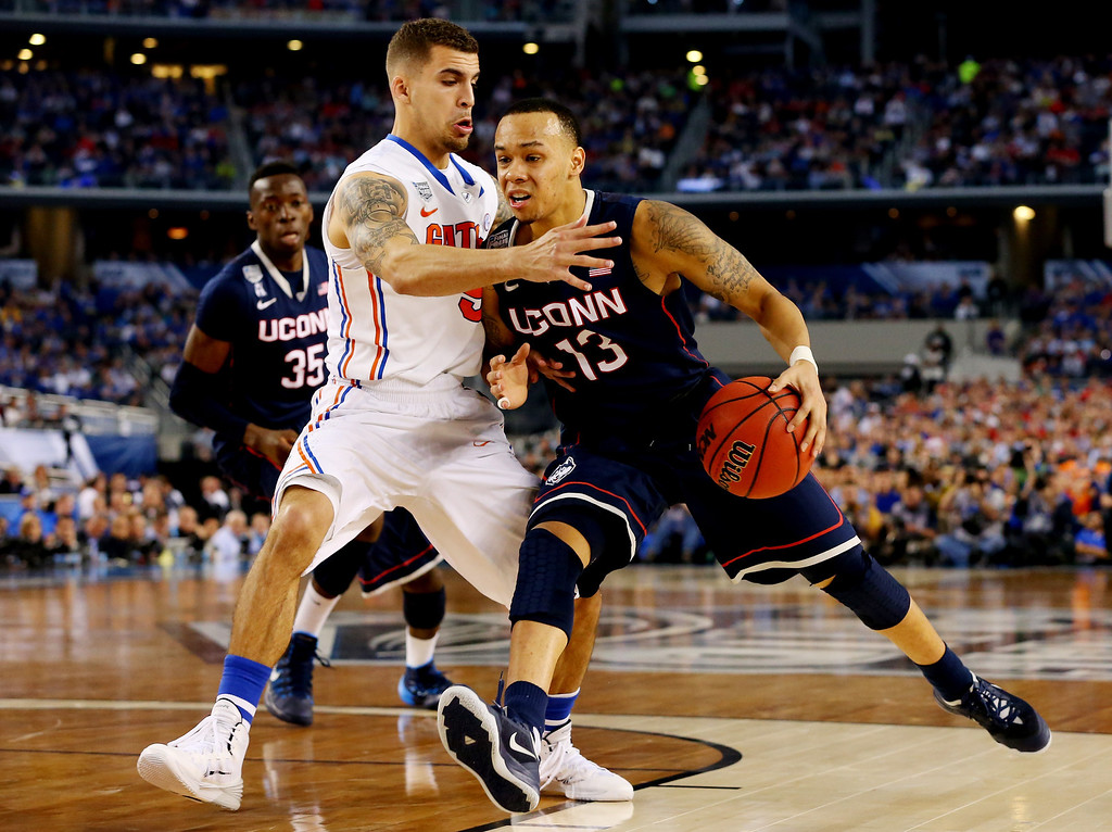 . ARLINGTON, TX - APRIL 05: Shabazz Napier #13 of the Connecticut Huskies goes to the basket as Scottie Wilbekin #5 of the Florida Gators defends during the NCAA Men\'s Final Four Semifinal at AT&T Stadium on April 5, 2014 in Arlington, Texas.  (Photo by Ronald Martinez/Getty Images)