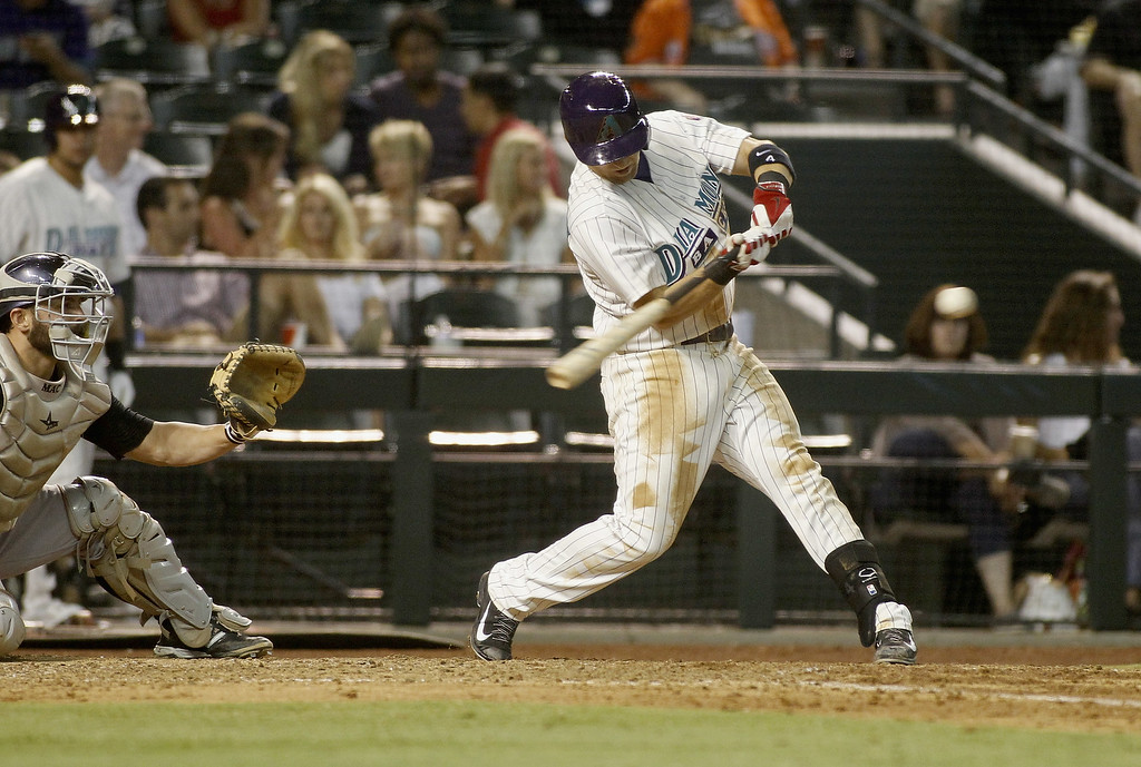 . Cliff Pennington #4 of the Arizona Diamondbacks hits a single against the Colorado Rockies during the sixth inning of a MLB game at Chase Field on August 30, 2014 in Phoenix, Arizona.  (Photo by Ralph Freso/Getty Images)