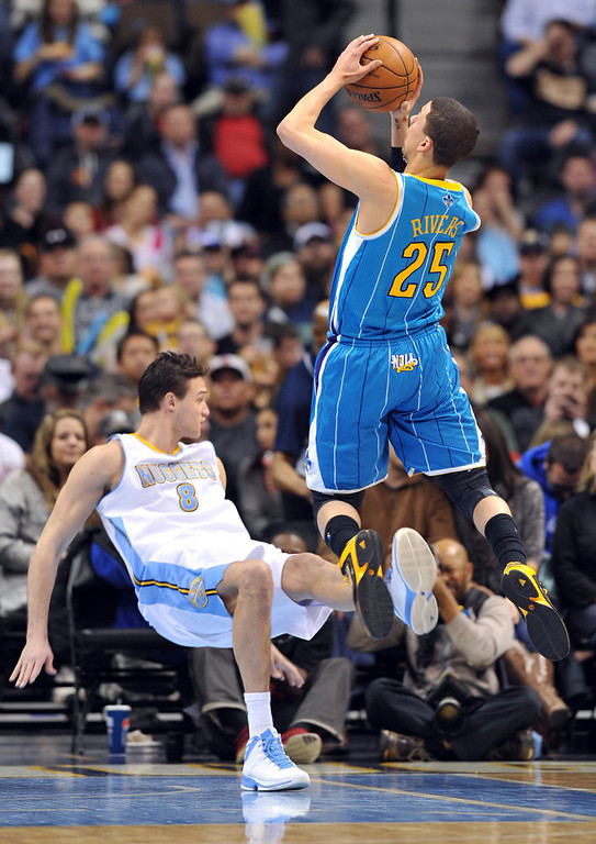 . DENVER, CO. - FEBRUARY 01: Danilo Gallinari of Denver Nuggets #8 is fouled by Austin Rivers of New Orleans Hornets #25 in the 1st half of the game on February 1, 2013 at the Pepsi Center in Denver, Colorado. (Photo By Hyoung Chang/The Denver Post)