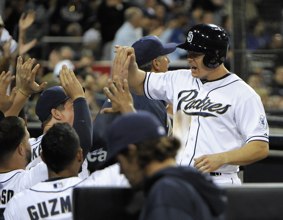 . SAN DIEGO, CA - APRIL 12:  Nick Hundley #4 of the San Diego Padres is congratulated after scoring in the seventh inning against the Colorado Rockies at Petco Park on April 12, 2013 in San Diego, California.  (Photo by Denis Poroy/Getty Images)