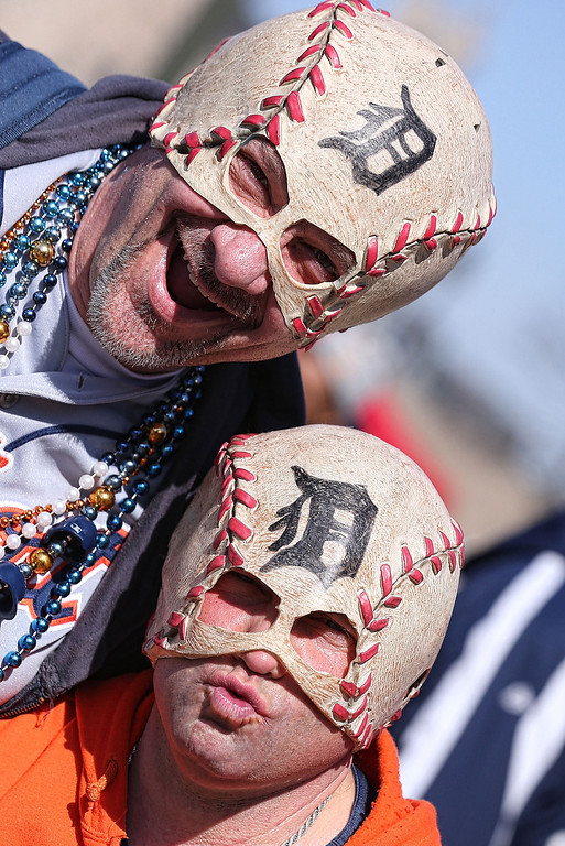 . Fans pose on Opening Day before the game between the Kansas City Royals and the Detroit Tigers at Comerica Park on March 31, 2014 in Detroit, Michigan.  (Photo by Leon Halip/Getty Images)
