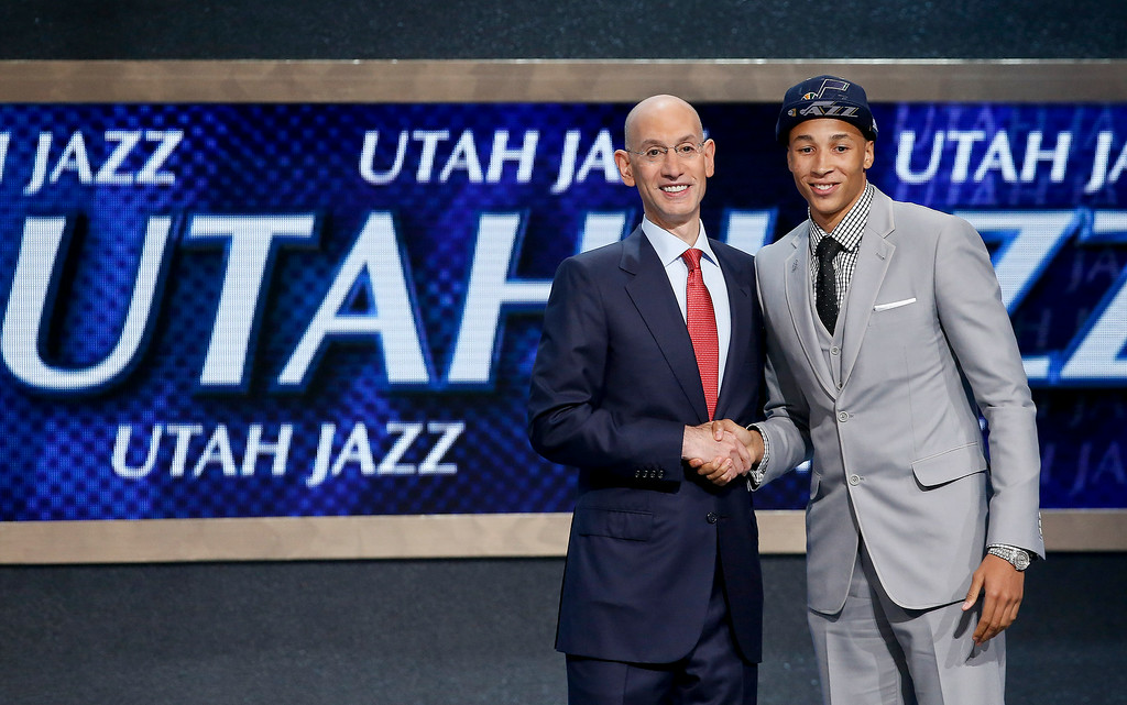 . Dante Exum, right, poses for a photo with NBA Commissioner Adam Silver after being selected by the Utah Jazz as the fifth overall pick during the 2014 NBA draft, Thursday, June 26, 2014, in New York. (AP Photo/Kathy Willens)