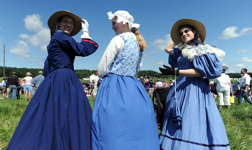 . From left: Carolyn Brent, her cousin Brienna Cheney and Brent\'s sister Courtney all watch the Hanover cavalry battle during the Blue Gray Alliance event at Bushey Farm on Saturday, June 29, 2013. YORK DAILY RECORD/SUNDAY NEWS--JASON PLOTKIN