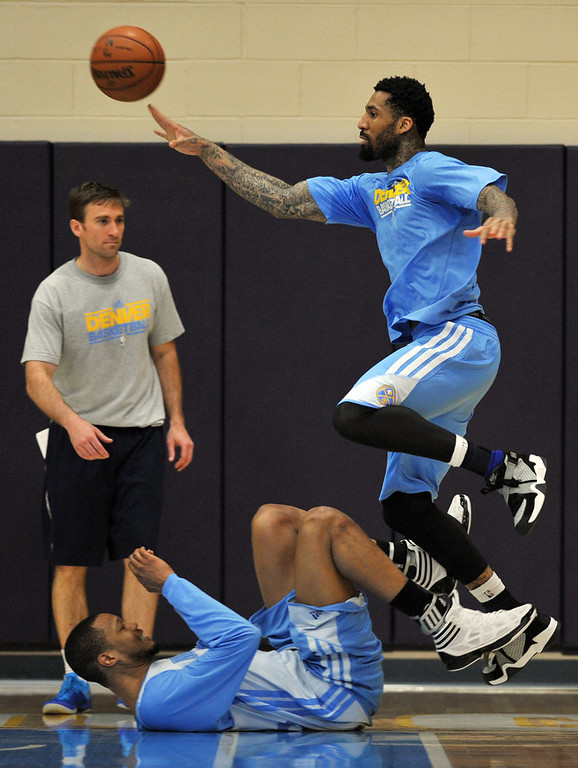. Wilson Chandler of Denver Nuggets, top, controls the ball over  Anthony Randolph, bottom, during the team practice for the 1st round of playoff game against Golden State Warriors at Pepsi Center. Denver. Denver, Colorado. April 19, 2013. (Photo By Hyoung Chang/The Denver Post)