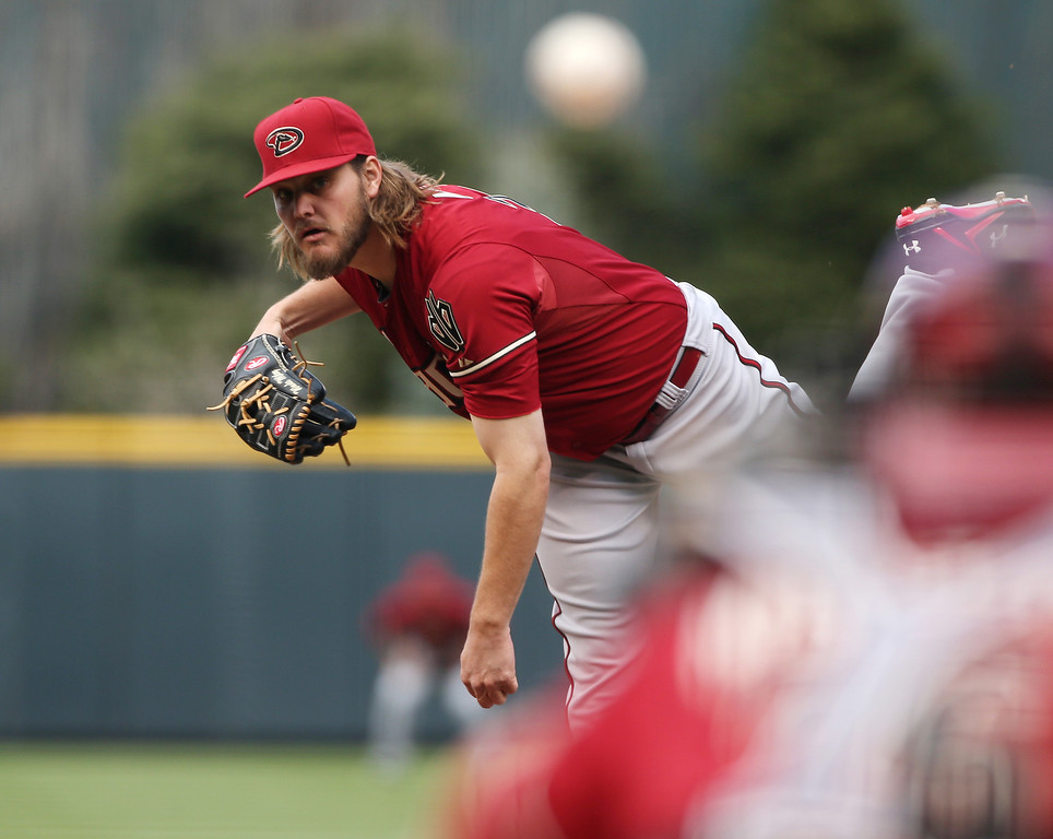 . Arizona Diamondbacks starting pitcher Wade Miley works against the Colorado Rockies in the first inning of a baseball game in Denver on Sunday, April 6, 2014. (AP Photo/David Zalubowski)