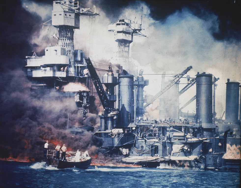 . In this Dec. 7, 1941 file photo, a  small boat rescues a USS West Virginia crew member from the water after the Japanese bombing of Pearl Harbor, Hawaii. With an eye on the immediate aftermath of the 1941 attack on Pearl Harbor, thousands of World War II veterans and other observers are expected on Sunday, Dec. 7, 2008 to commemorate the 67th anniversary of the devastating Japanese military raid. (AP Photo)