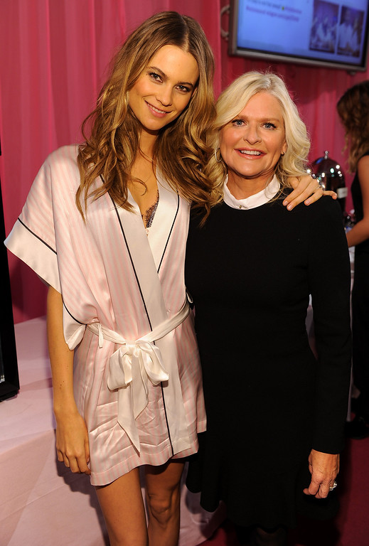 . Model Behati Prinsloo (L) and CEO and President of Victoria\'s Secret Sharen Turney pose at the 2013 Victoria\'s Secret Fashion Show hair and make-up room at Lexington Avenue Armory on November 13, 2013 in New York City.  (Photo by Dimitrios Kambouris/Getty Images for Victoria\'s Secret)